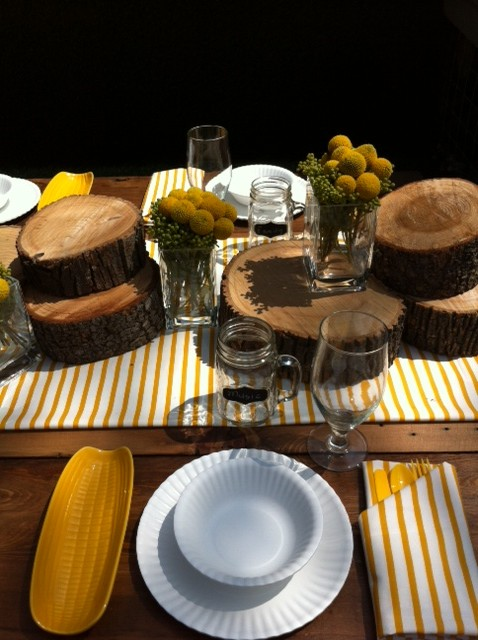 "Unison Sailor Mustard Table Linens on set of ""I Hate My Yard"""