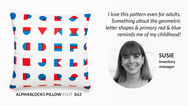"Susie, inventory manager, explains why she picked the alpha blocks pillow: ""I love this pattern even for adults. Something about the geometric letter shapes & primary red & blue reminds me of my childhood!"""