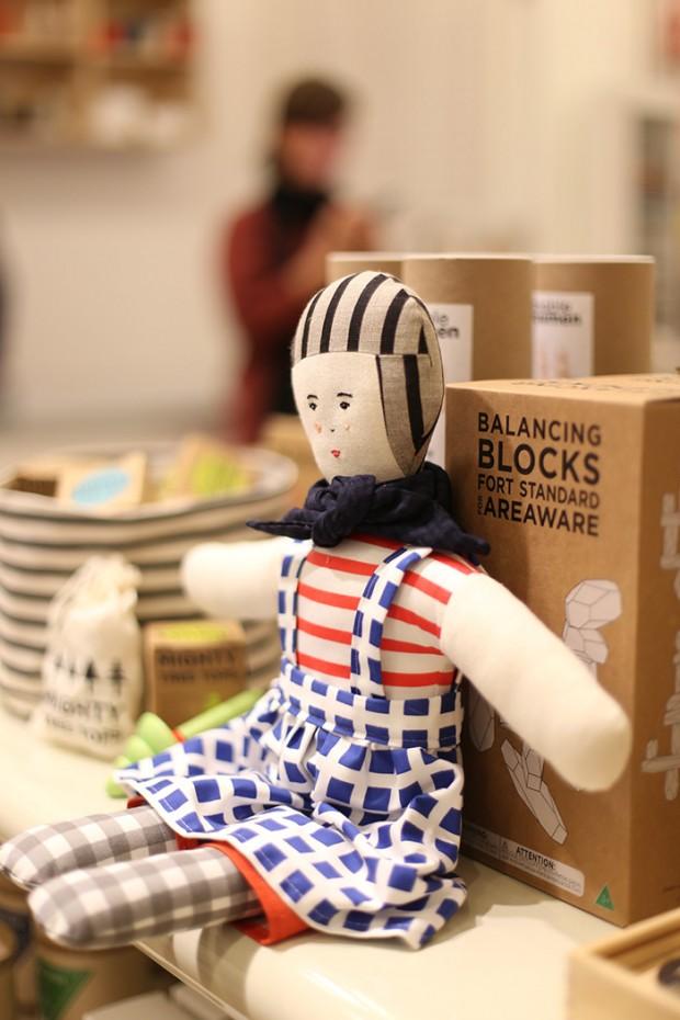 Scrap fabric doll on display