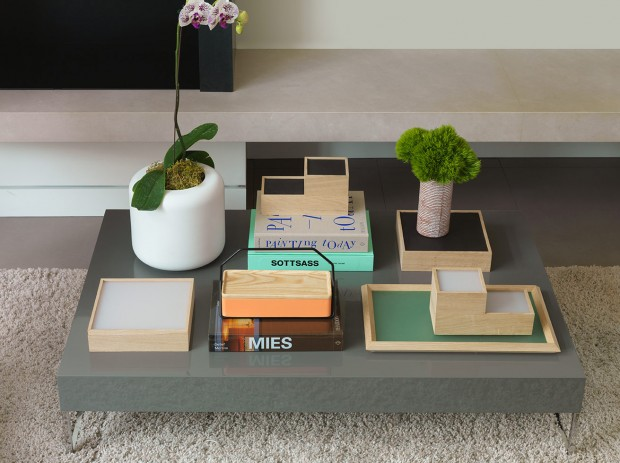 A coffee table with modern accessories